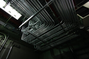 complex metal pipe system attached to ceiling