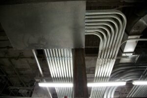 metal pipes attached to concrete ceiling