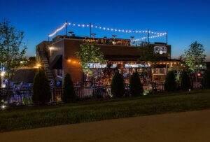 exterior photo of Wellman's Pub at night