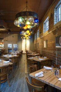 restaurant dining area with unique modern round chandeliers