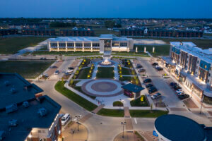 overhead shot of The District - Prairie Trail walking path and fountain at night