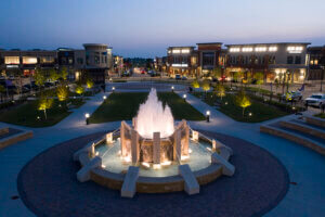large circular water feature and lit walkway at Prairie View at night
