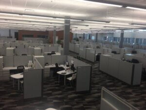 large office space with grey cubicles