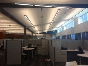 modern office space with bright overhead lighting