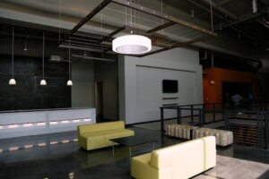 modern interior with LED light fixtures and yellow couches