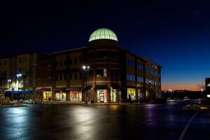 photo of retail building with glass illuminated dome at night