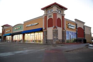exterior photo of retail building with the Vitamin Shoppe, Orange Leaf, and Aspen Dental