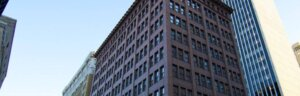 exterior photo of downtown brick residential building