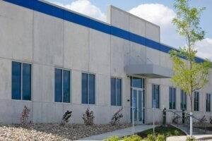 exterior photo of concrete Putco building entrance