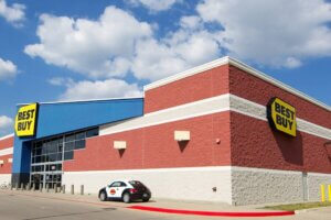 exterior shot of brick Best Buy store with blue sky and clouds
