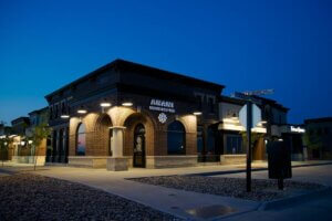 exterior photo of brick building with Anani Salon & Spa at night