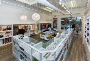 white retail jewelry counter with crystal chandeliers and overhead lighting