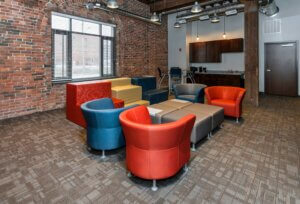 modern interior with brick wall and colorful armchairs