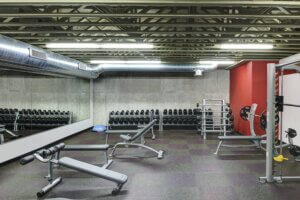 free weights room with lighting overhead